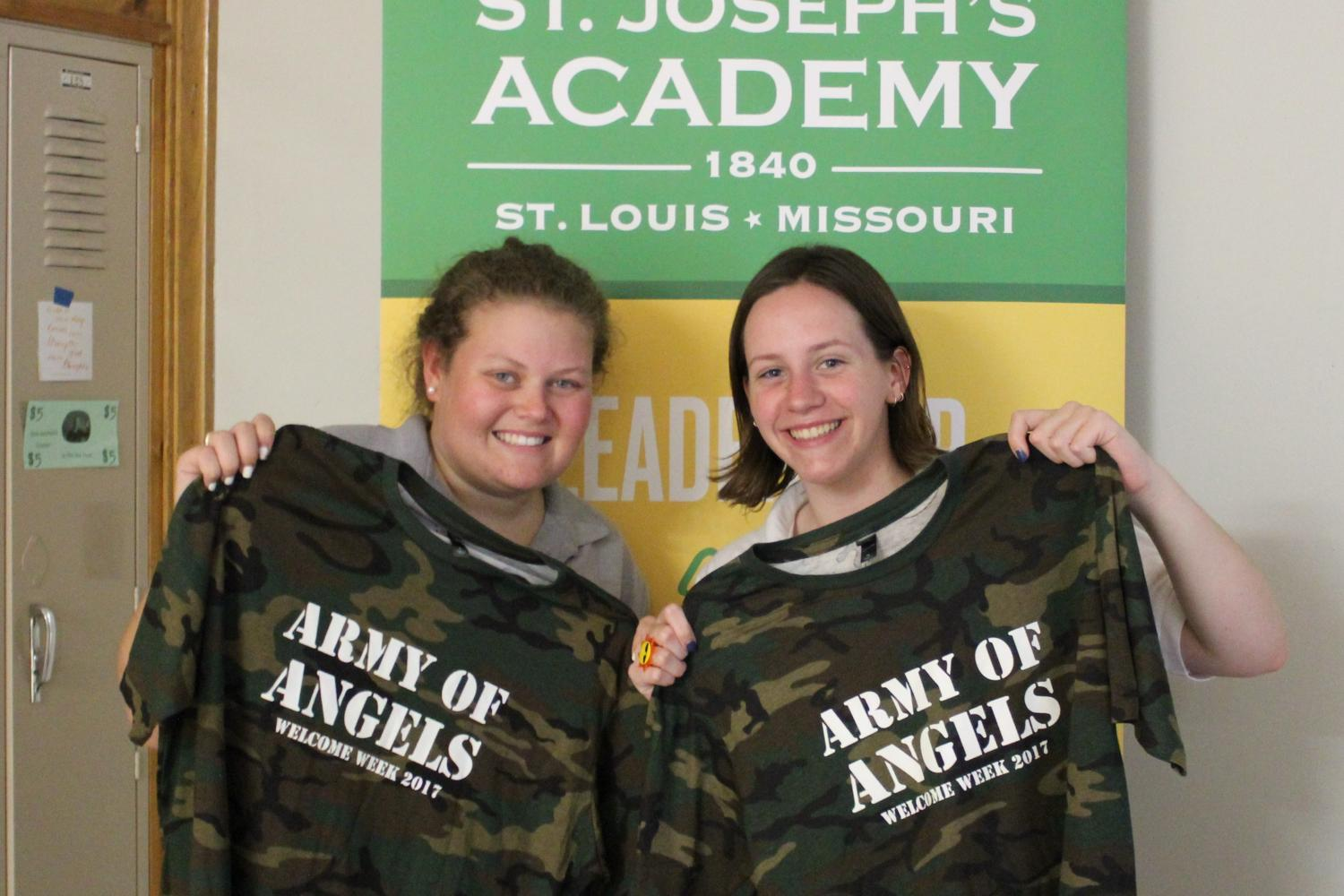 Seniors+Erin+Combs+and+Grace+Cheney+show+off+their+adorable+welcome+week+tee-shirts.