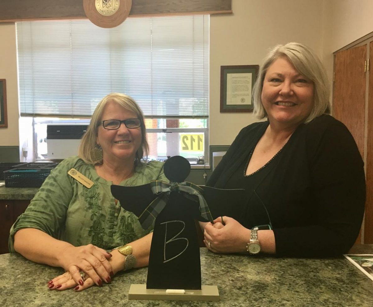 Melody DeGeare and Laura Baxendale in the front office