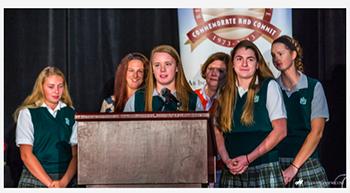 Sophomore Kara Greger, Mrs, Hammell, junior Helen Ann Stone, Mrs. Sudekum, junior Maggie Hannick, and junior Lauren Gallagher accept the Bishop McNicholas Award on Oct. 22.