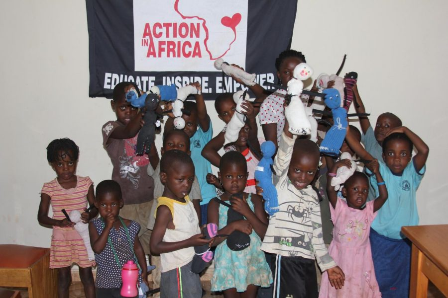Action+in+Africa+works+with+children+to+make+dolls.