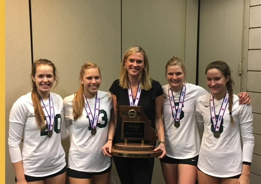 Katie+Richardson+poses+with+her+senior+volleyball+players%2C+Morgan+Smith%2C+Gabby+Blossom%2CMadison+Gresham%2C+and+Claire+Ochs%2C+after+winning+State+in+2017.+