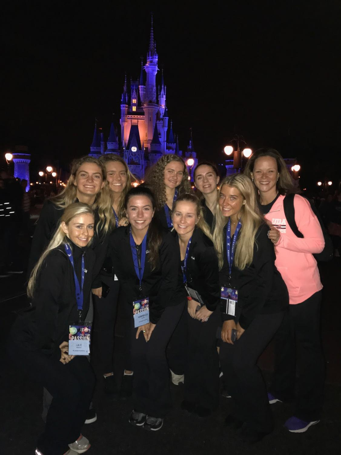 The team poses in front of Cinderella's Castle.