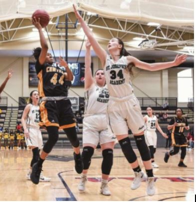 On March 10th, Senior Alex Kerr demonstrates her defensive presence in a game against Hazelwood Central.