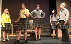 (Left to right) Maggie Kutz as Meg, Hannah Kinnison as Jo, Mary Hayes as Marmie, Julia Ringhausen as Beth, Rosie Schibig as Amy.