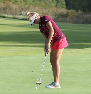 Grace Aromando swings during a St. Joe golf tournament.