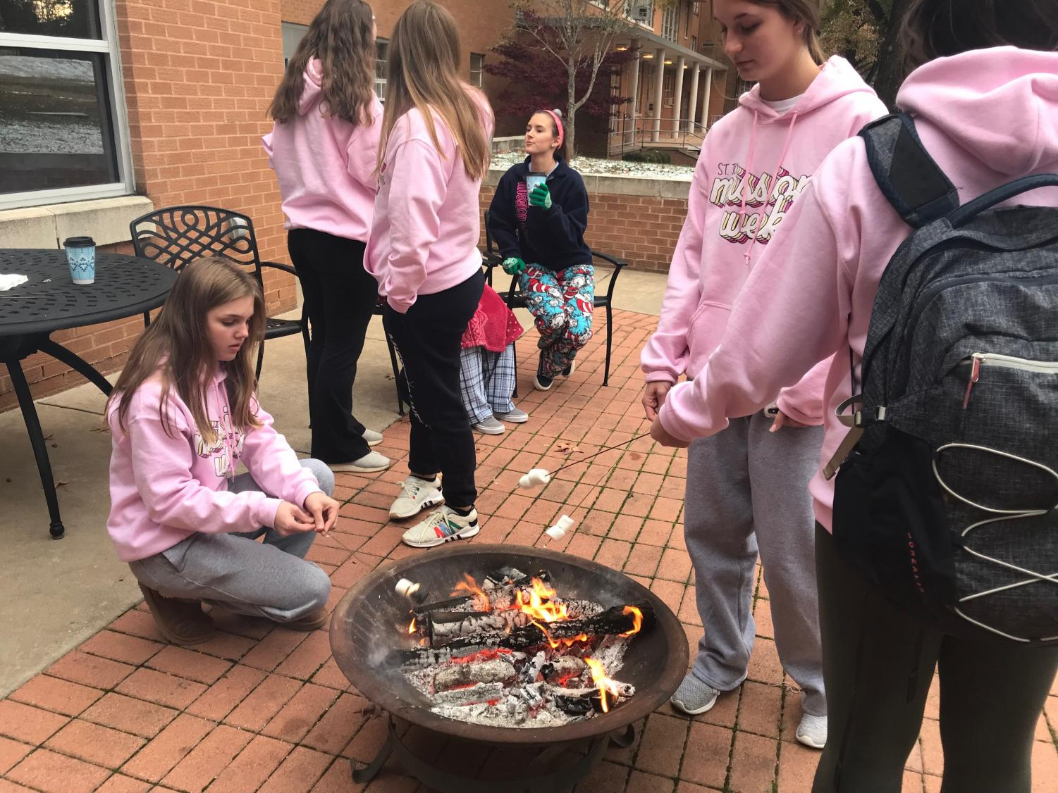 Sophomore enjoy making smores at their class fundraiser on Wednesday.