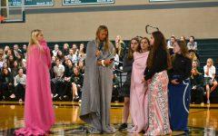 Sophomore officers prepare to reveal their mission week garments.