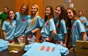 Sophomores show off their mission T-shirts.