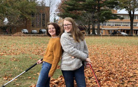 Freshmen Jenny Niehaus and Lauren Dignam raking leaves for Sunday service!