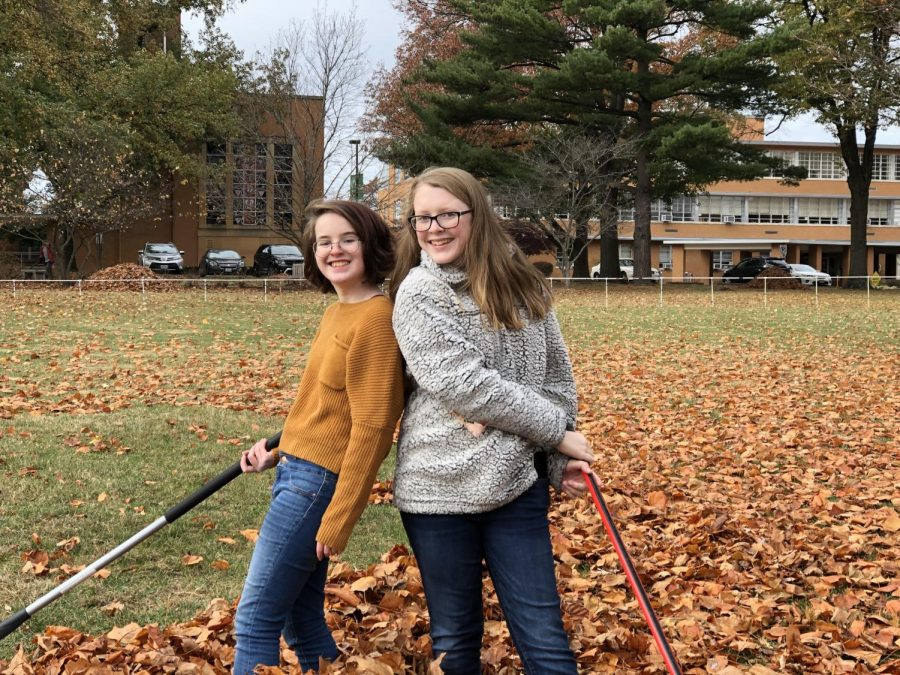 Freshmen Jenny Niehaus and Lauren Dignam raking leaves for Sunday service!