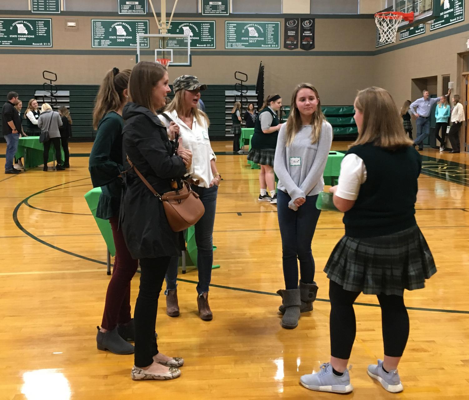 Student ambassadors greet families in the gym before taking them on a tour of St. Joseph. Photo: Claire Price