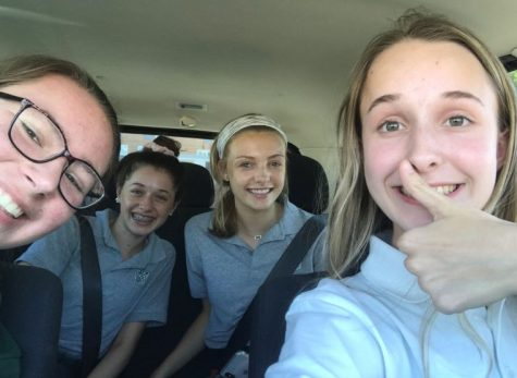 Junior Rachel Esser, Sophomore Julia Erker, Freshman Anna Vincent, and Junior Haley Pruett, carpool of the month, on their way to ST. Joe.