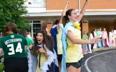 Seniors Victoria Unnerstal (left), Katherine Chalmers (right), and their classmates welcome the underclassmen on St. Joe day.