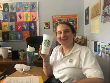 Sophomore Cate Van Luven shows off both her reusable water bottle and reusable Starbucks cup.