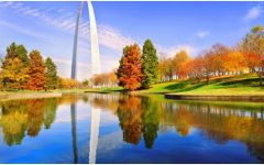 The St. Louis arch in a view of an autumn landscape.