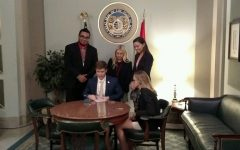 Olivia Staph and Kara Greger get their bill signed into law!