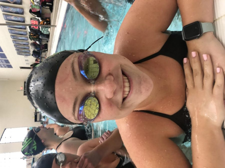 Junior Libby Shuman always brings a smile with her to swim practice.