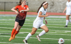 St. Joseph's Greta Seal (right) makes a run as Summit's Anna Walsh chases during a Class 3 soccer sectional on Monday, May 20, 2019 at Summit High School in Fenton, Mo. Paul Kopsky.