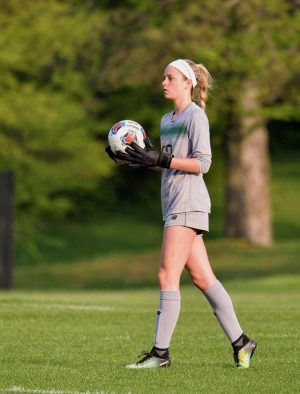 STUCO President Flynn shows her skills as a goalie on the St. Joe soccer team.