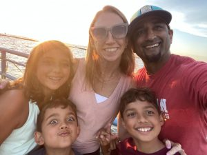 Ms. Shah, her husband, and their three kids while traveling over the summer.