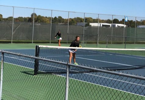 Abby Gaines taking a serve at state.