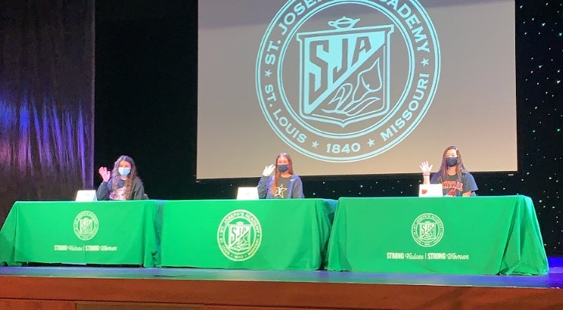 Seniors (from Left to Right) Kara Hauser, Emma Mueller, and Nicole Rallo signing their Nation Letter of Intent in the SJA's theatre on November 11.