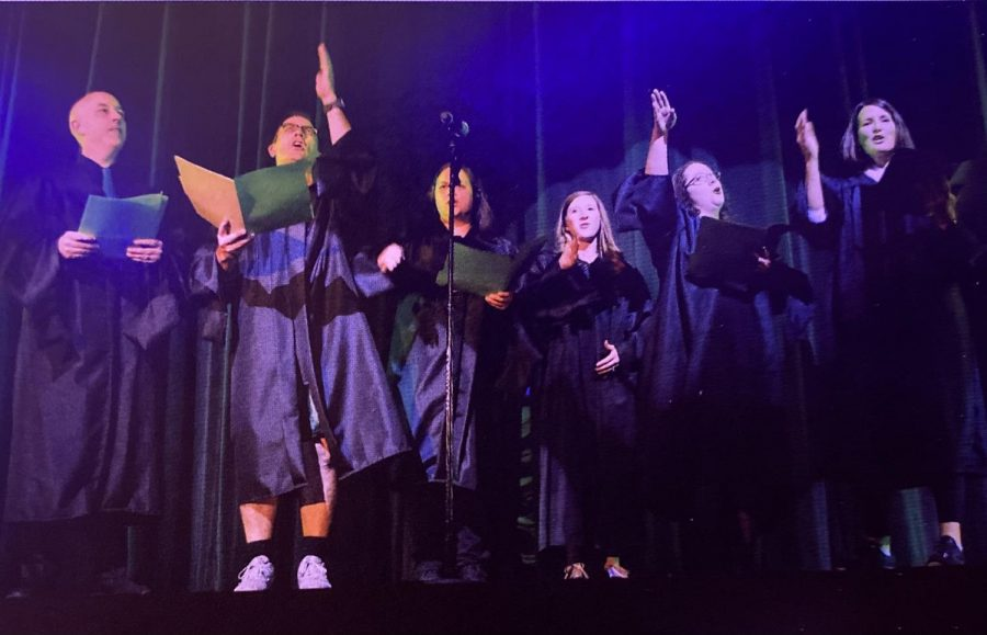 Teachers sing the St. Joe Song at the 2019 Faculty Show.