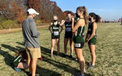 Coach Scott House talking to the girls before a race.