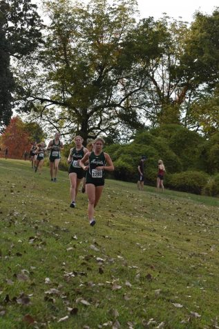 Senior Kathryn James striving for victory during a cross country meet.