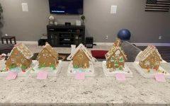 Senior Flynn Wiegner's family ranks their gingerbread house winner.