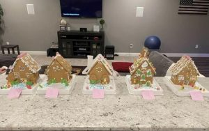 Senior Flynn Wiegner's family ranks their gingerbread house winner.