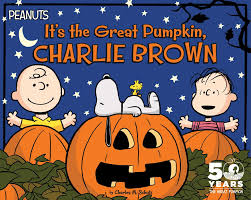 "Charlie Brown and his friend Linus, Snoopy, and Woodstock celebrating the 50th Anniversary of Peanuts and the movie ""It's the Great Pumpkin Charlie Brown."""
