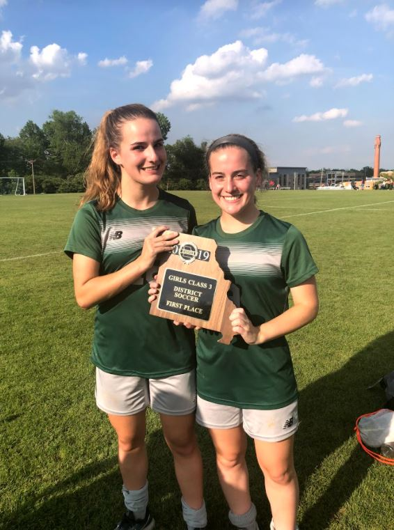 Ella Kertz (right) and her twin sister Grace Kertz (left) after winning first place in the district championship in 2019