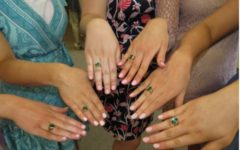 Past Juniors show off their rings at their Junior Ring ceremony.
