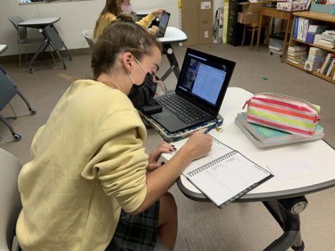 Senior Ella Kertz using her planner to stay organized